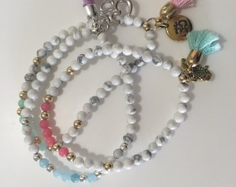 Beautiful semi-precious stacking bracelets with charms