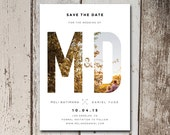 Sweet save the date card with a personal photo layered behind bold initials.