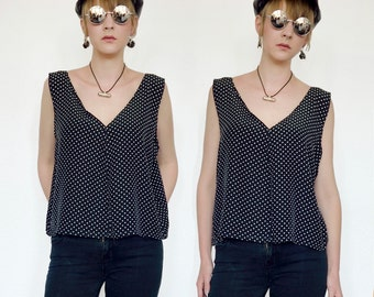 Black summer top with small white polka dots.
