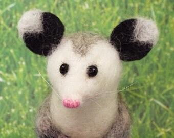 Needlefelted possum finger puppet.