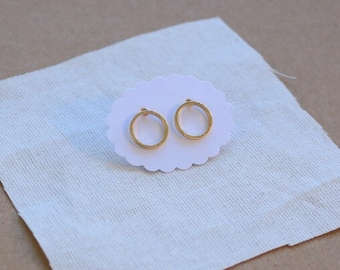 delicate gold circle studs