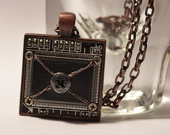 Cyberpunk Industrial style circuit board necklace.