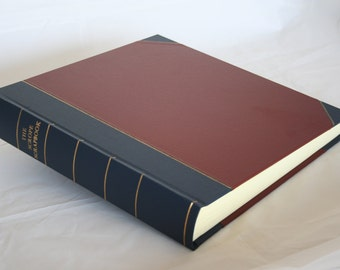 "Large Traditional 12 x 12""  Photo album bound in 1/2 blue and red cloth"