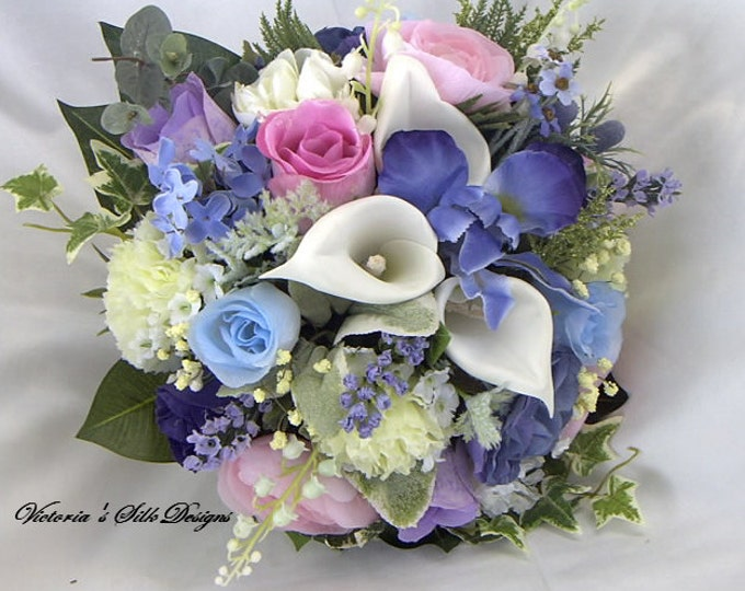 Silk  wedding bouquet made of Iris ,roses, and callas . Blue. pink lavender and white nosegay style