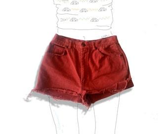 High waisted orange denim cut off shorts