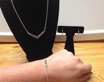 AVON Dancing Purple Shimmer Necklace, Bracelet, and Earring Set In Original Box