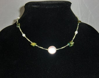 Simple pearl and bead necklace in greens and white pearls