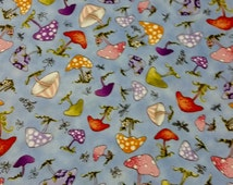 Quilting Treasures Very Fairy 100% cotton fabric, blue back ground with red, purple, white, pink, & green mushrooms. ~17