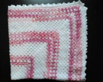 Hand made crochet babies blanket in shades of pink and white with picot edging