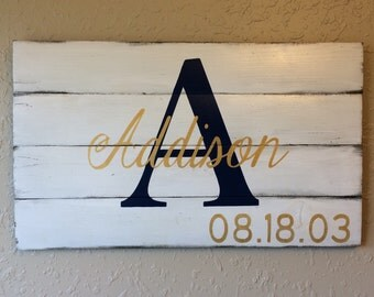 Personalized wall hangings on distressed reclaimed wood. Includes momogramed first initial, first name and birthdate.