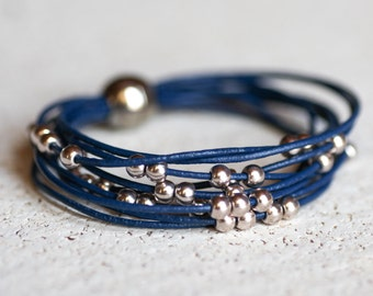 Blue leather bracelet with silver beads.  Magnetic clasp