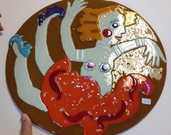 Dancing Lady is fused glass.She is 14 inches round