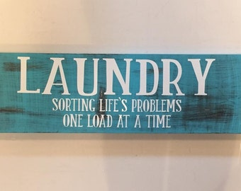 Laundry sign/ teal, black, and white