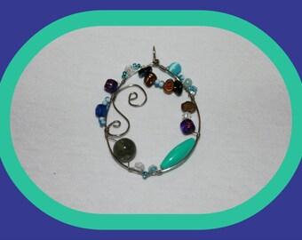 Handmade oval beaded pendent