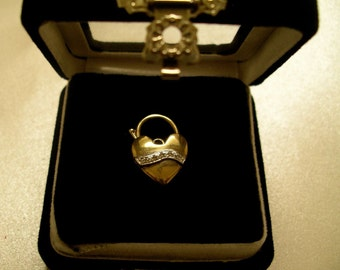 9K Gold and Diamond heart-shaped pendant. With Box and Valuation. Great gift idea!