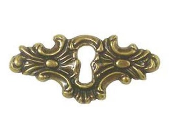 "An antique brass Finish, Horizontal ornamental keyhole cover plate and two brads, AN0199, Dimensions: 2 1/4"" x 1"""