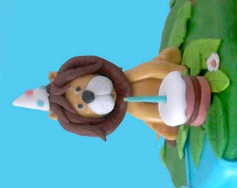Fondant Lion Cake Topper, Birthday lion blowing his cake wearing a party hat!
