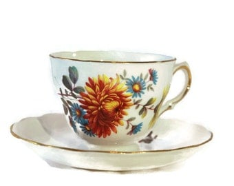 Vintage Queen Anne footed tea cup pattern no: 8304 with Mums and Daisies