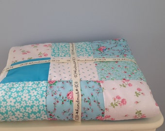 Childrens blue, white and pink patchwork quilt