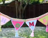 "Unique Crochet ""Home"" bunting, banner, garland, wall hanging with coordinating flowers, buttons and tassels. Unique and handmade."