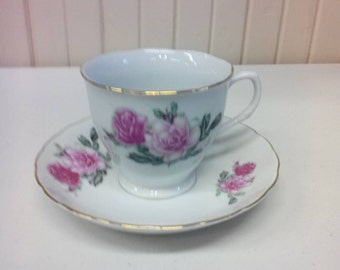 Teacup and saucer made in China with pink roses
