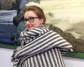 Large blanket shawl woven in 100% pure British wool using the natural coloured wool of Welsh Black Mountain and Jacob sheep, warm and cosy.