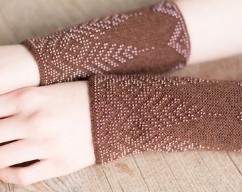 Hand-knitted brown color wrist warmers decorated with brown beads
