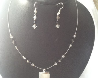 Set necklace and earrings in silver, black and transparent swarovski stones