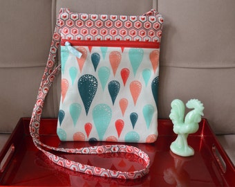 Sling bag in teal and red teardrop and coordinating fabric