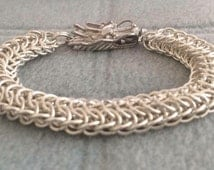 Dragon back weave bracelet with dragons head clasp