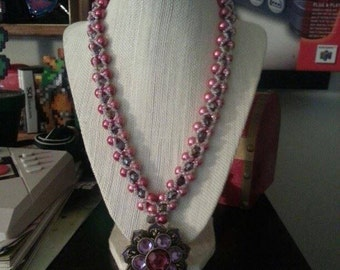 pearl emblashed necklace with flower pendent