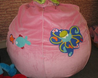 Colorful bean bag chair with happy, funny creatures stitched.