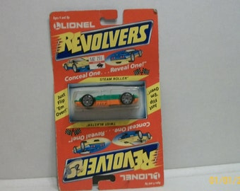 VINTAGE 1989 Lionel  Revolvers Conceal One Reveal One Steam Roller or Twist Blaster 1/64 Scale Flip Car New on Card