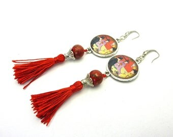 Asian-inspired earrings and her Pompom charm