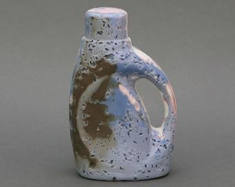 Unglazed ceramic sculpture