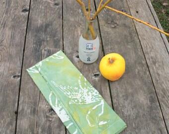 mottled green linen tea towel with birds