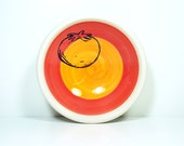 small dish, with a tomato on a color block of red-orange & creamsicle, made to order.