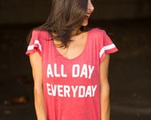 All Day Everyday.  Wide Shouldered Flutter Sleeve Flowy Muscle Tee.  Sport Striped Off Shoulder Tee.  Attitude Tee.  Sporty Tee.  USA Made.