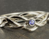 Natural tanzanite puzzle ring in sterling silver