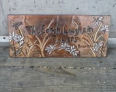 The Earth Laughs Wall Plaque