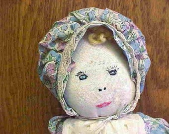 AN ADORABLE SOCKDOLL-Vintage--Handmade--Sweet Floral Print Dress w/Eyelet Bodice--Embroidered Face and Yellow Yarn Hair.
