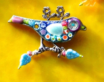 Imaginary Mosaic Bird Brooch Pin With a Purple Surrounded eye Bright Green Beak Blue Wing Purple Tail Feathers Orange Star Millefiori Daisy