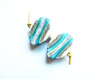SILVERED TEAL LAYERS  2 ivory, silver, dark and light teal, and silvered ivory matte finish zulus earring pair   A Beaded Gift