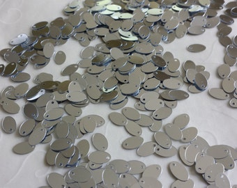 New item -- 7g of 8x5 mm Side Hole Oval Sequins in Metallic Silver Color (approximately 780 ct.)