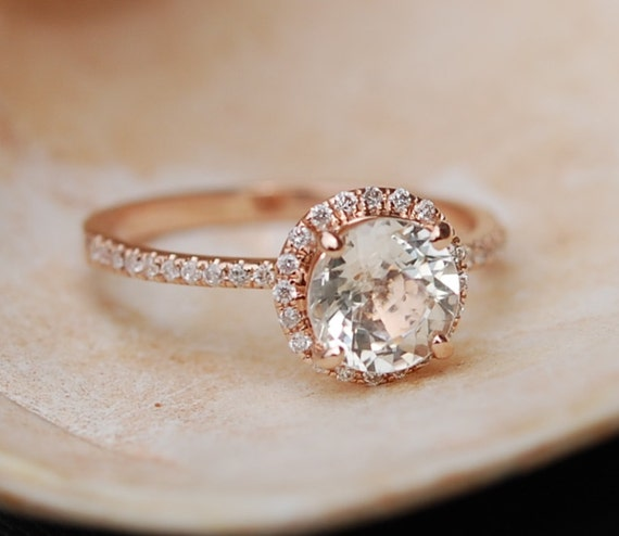Rose gold diamond ring engagement ring with 1.9ct round white sapphire. Diamond halo rings
