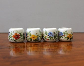 Single candle holders with florals, Funny Design West Geranium.  Set of four.