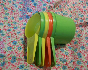 colorful fun tupperware measuring cups