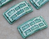 Ride em like you stole em...a handmade pottery cuff bead with an attitude in Emerald Green