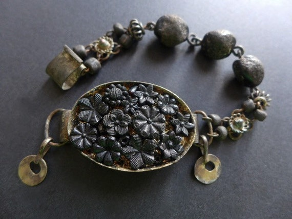 Night's teeth.  Rustic assemblage beaded bracelet in black with antique French carved jet flowers.
