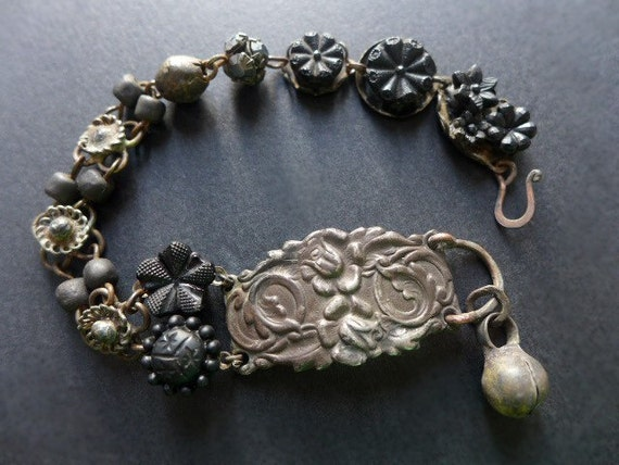 The Waiting Darkness. Rustic assemblage beaded bracelet in black with antique French carved jet flowers.